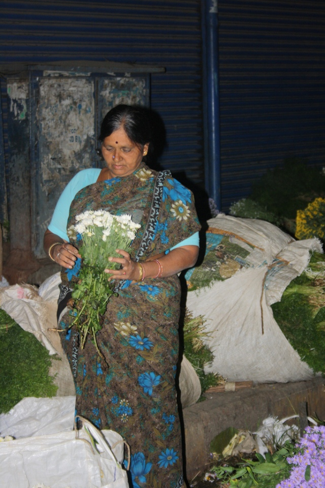 One gracious lady checking the freshness of flower