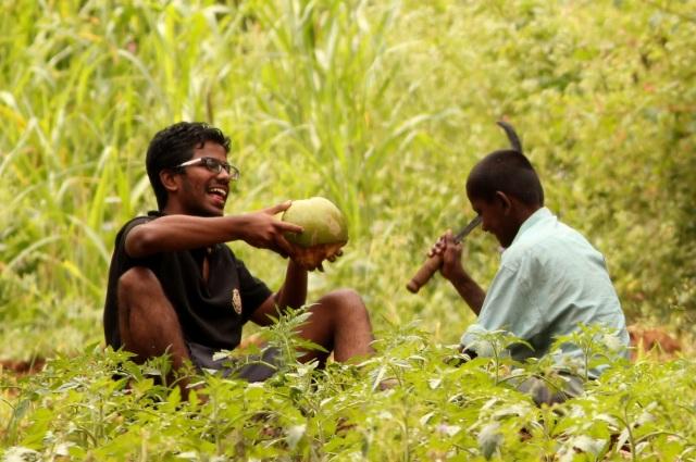 Chandu enjoying coconut water